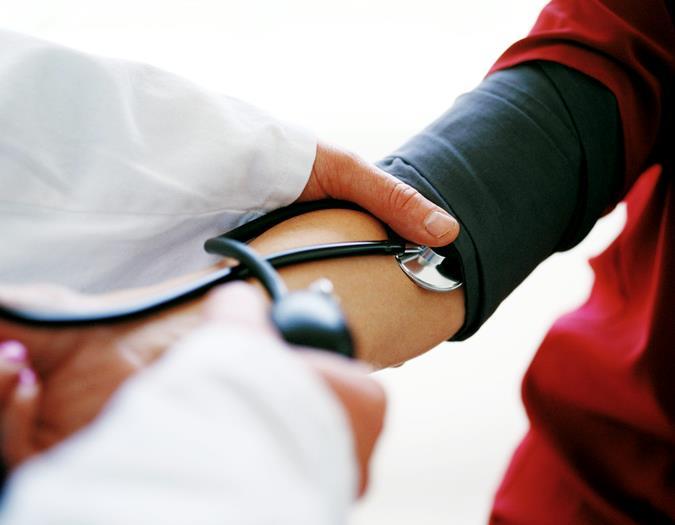 A docter checking the blood pressure of someone