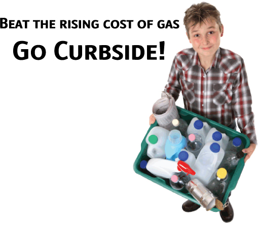 Boy holding recycling bin full of plastic jugs and other recyclable items