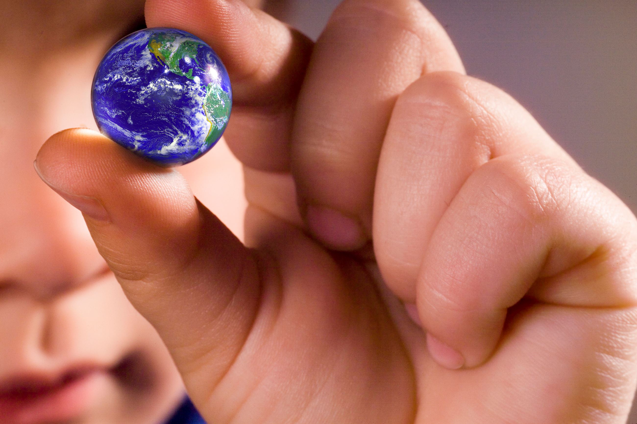 kids hand with earth