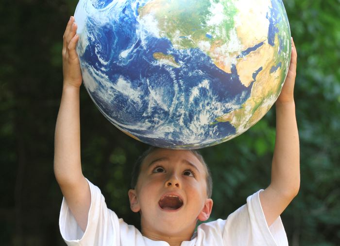 kid holding earth overhead