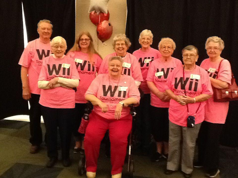 A group of people in matching, pink, wii t-shirts