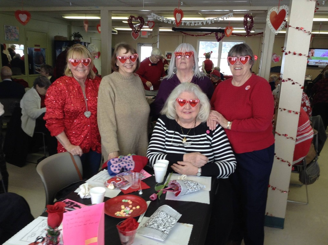Women at a Valentines party with heart decorations